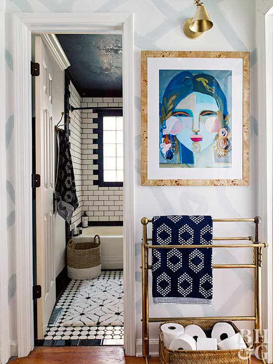 bathroom entry with gold accents