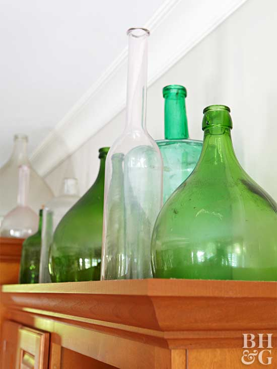 green and clear bottles on display