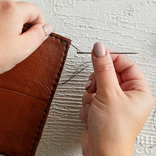 sewing around edge of leather wallet