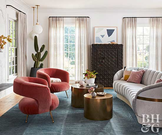 retro living room with red velvet chairs