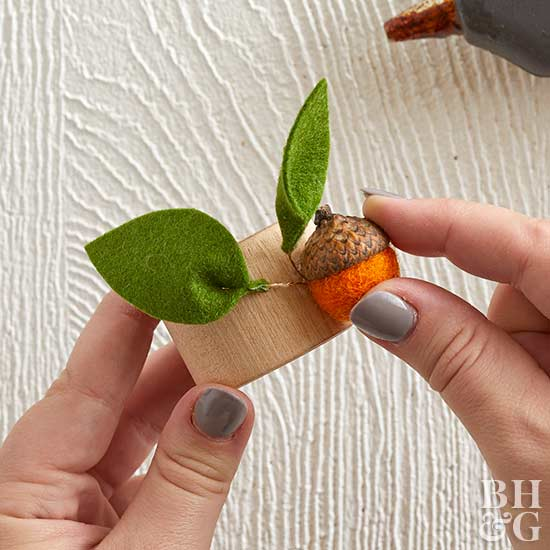 placing felt acorn with leaves