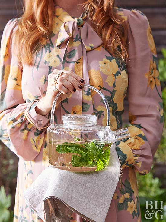 woman holding pitcher