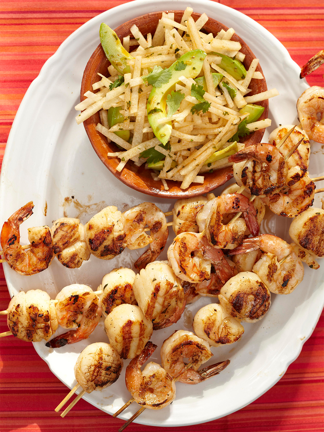 Grilled Drunken Shrimp and Scallop Skewers with avocado salad