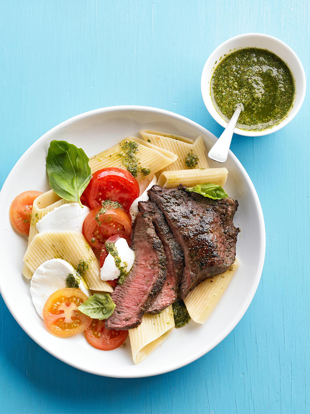 Caprese Pasta and Steak with fresh mozzarella, tomatoes, and pesto sauce