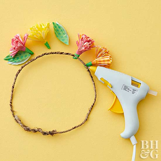 hot-glue flowers to twine