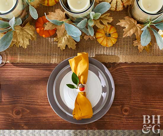 plate with yellow napkin and pumpkins