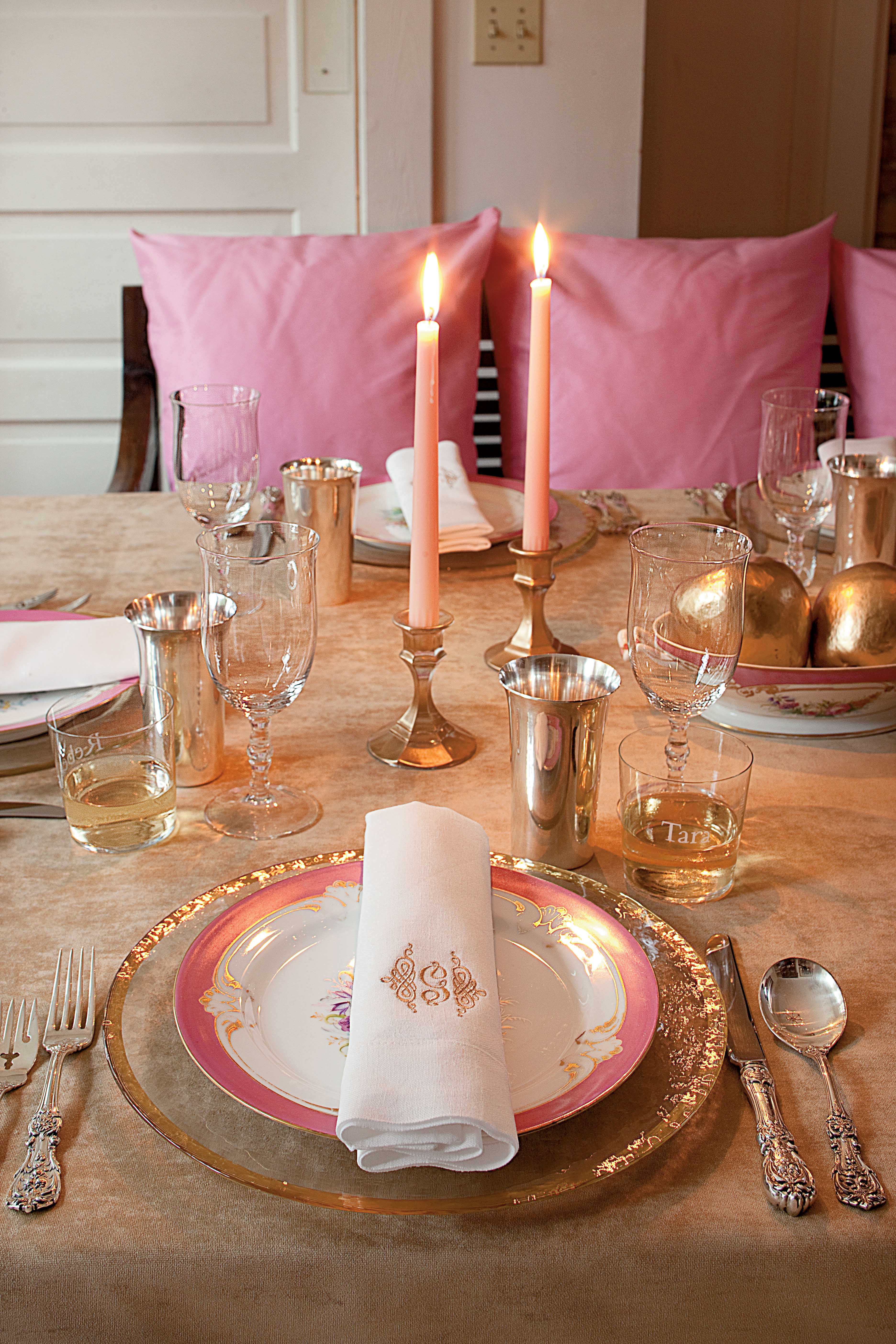 Pink pillows and pink and gold table setting
