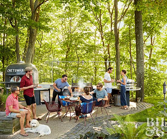 adults grilling and socializing on patio