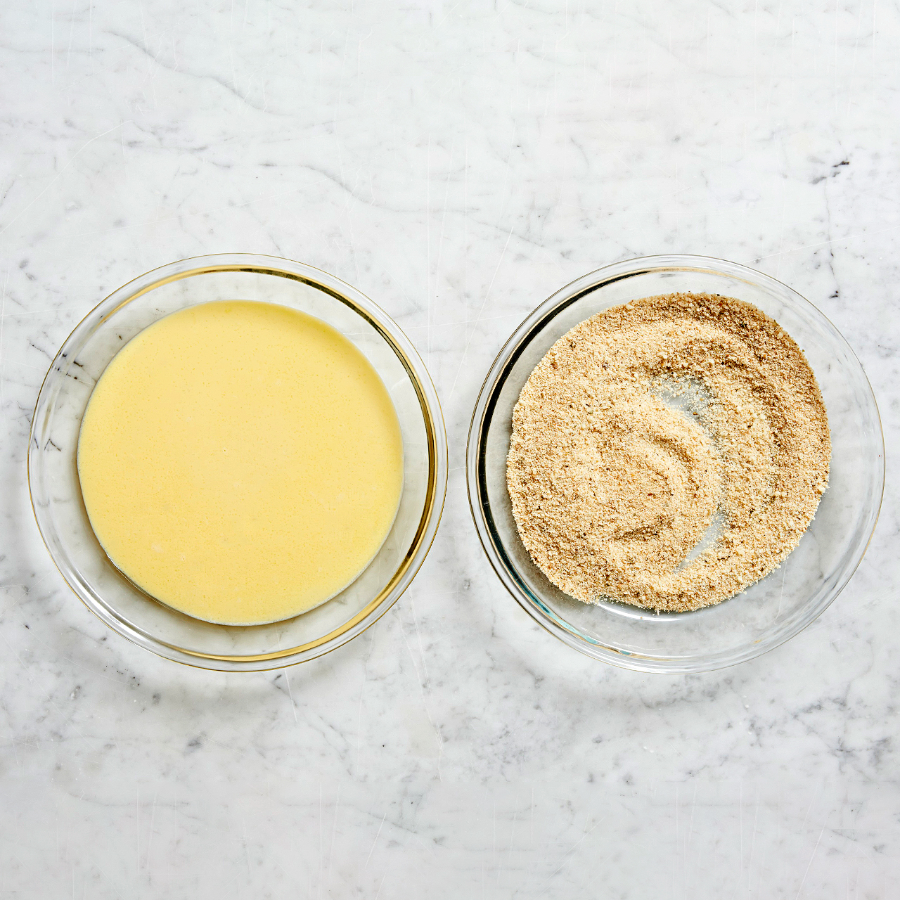 egg mixture and bread crumbs in dishes