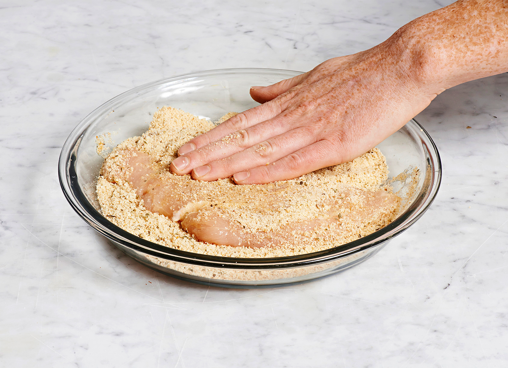cover chicken with bread crumbs