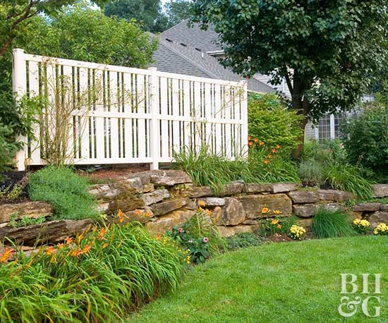 Slope, Backyard, Fence, Stone Wall, Lawn, BHG.com, Better Homes and Gardens