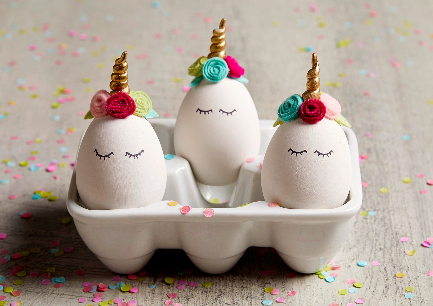 completed unicorn eggs in white holder