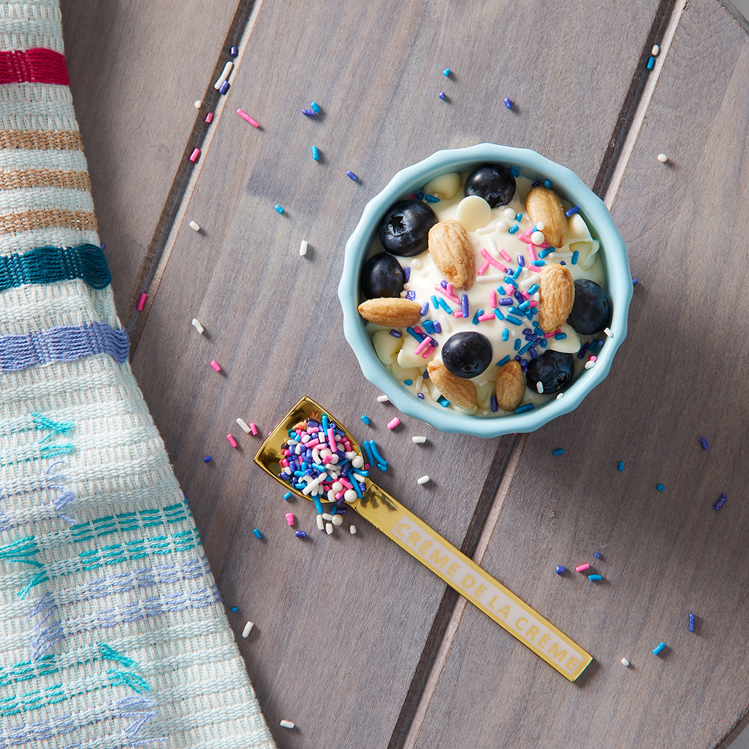 blueberries and sprinkles on ice cream