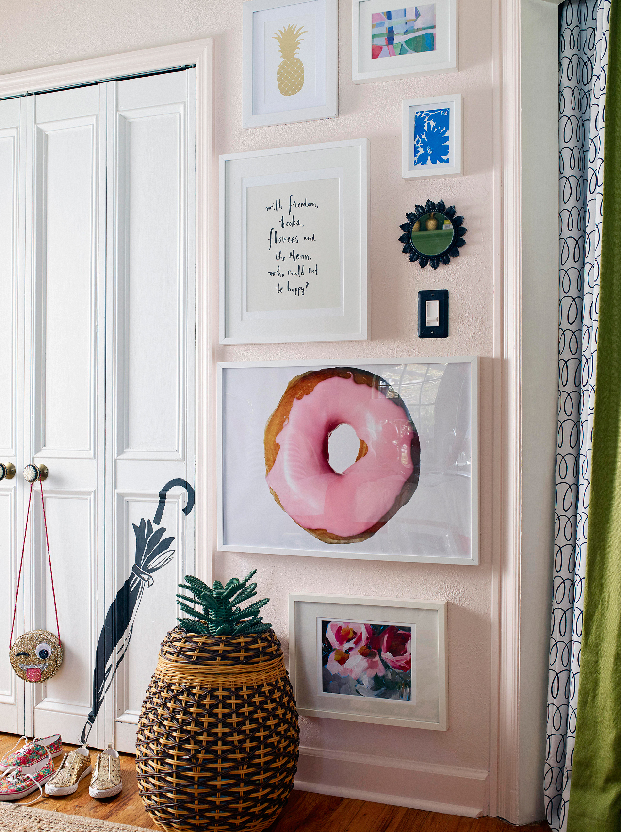 feminine entryway with pink walls and artwork