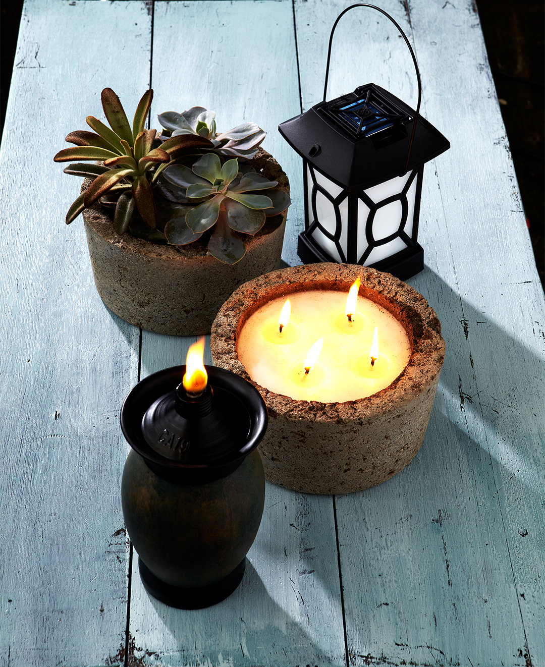 picnic table mosquito repellent products candles plants lantern