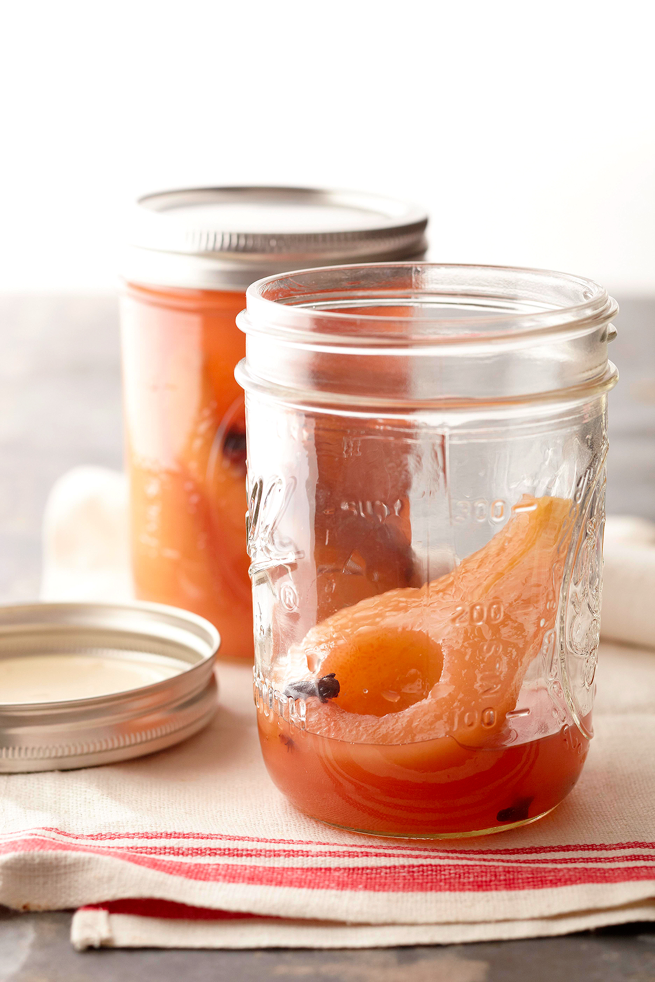 mason jars with brandied honey-spice pears