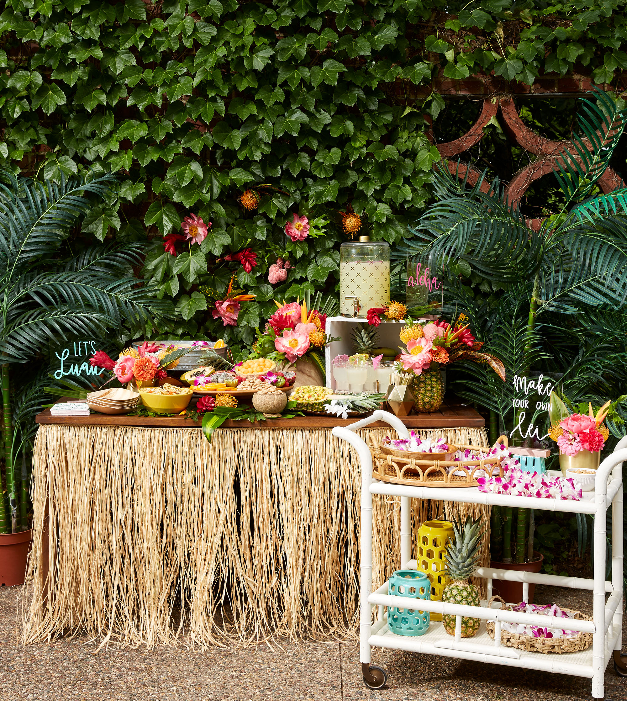 food table with grass skirt white cart