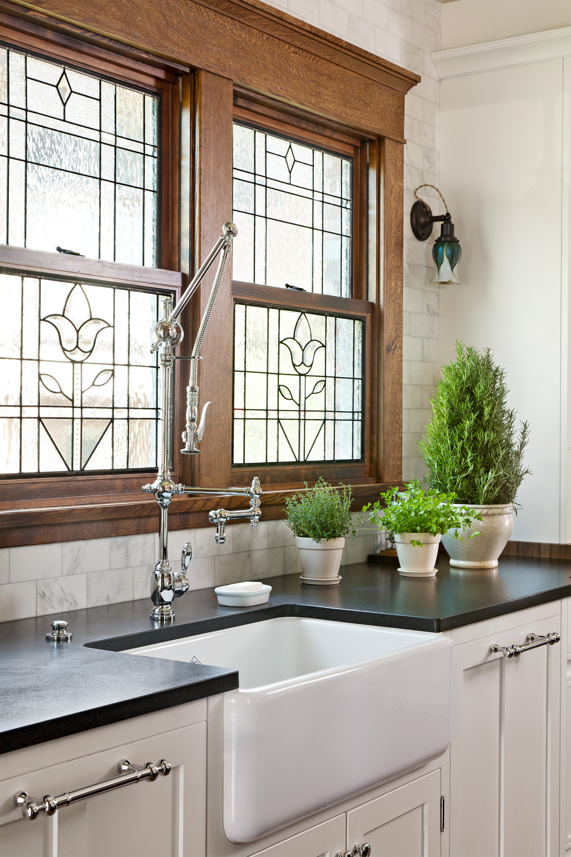 leaded glass windows over farmhouse sink in kitchen