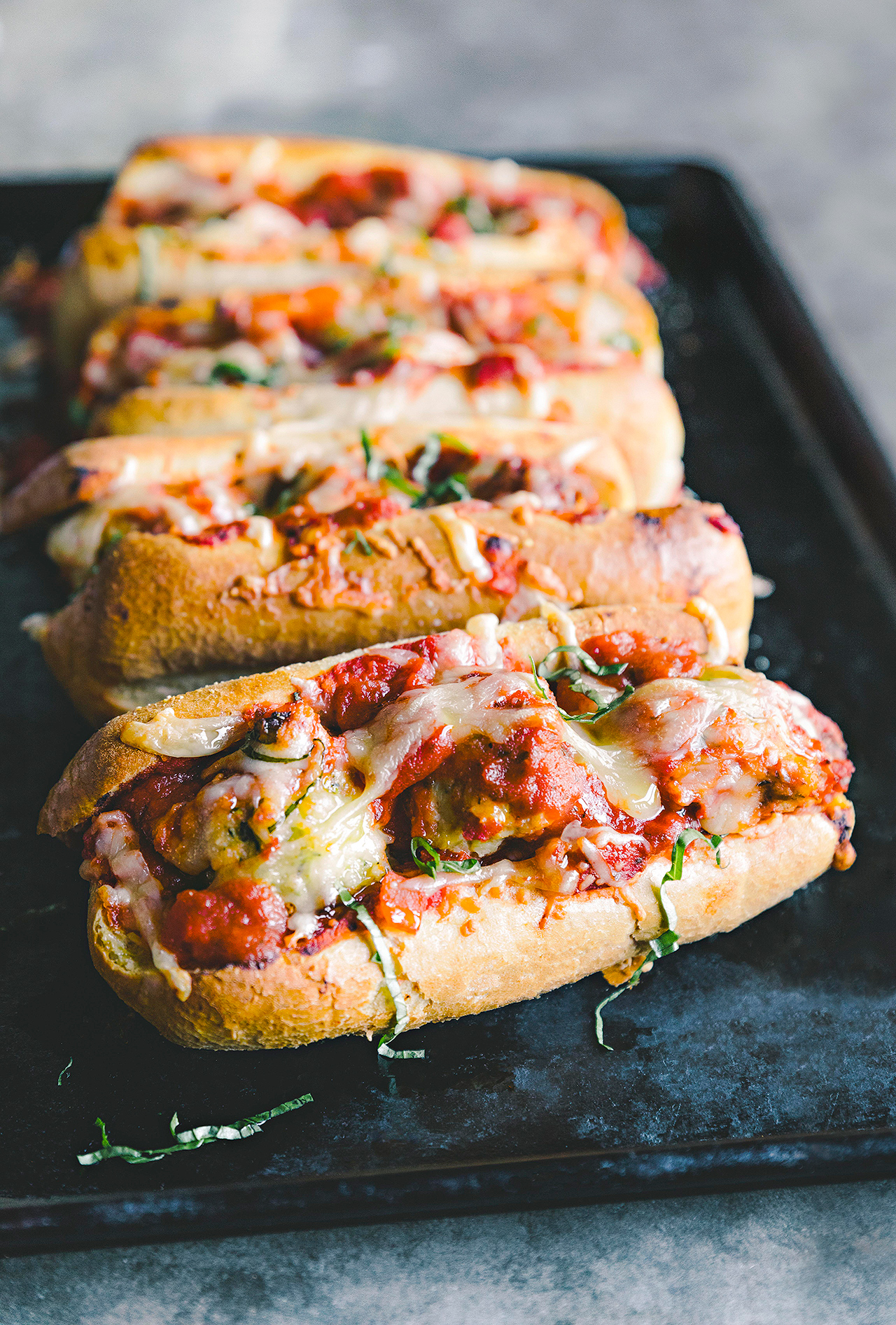 Chicken-Zucchini Meatball Subs on pan
