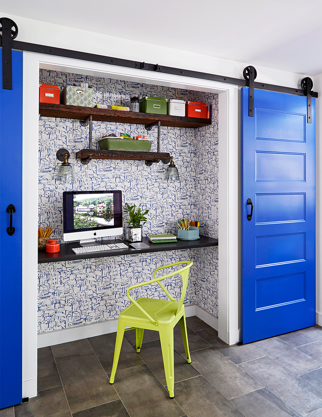 office nook in closet with blue sliding doors