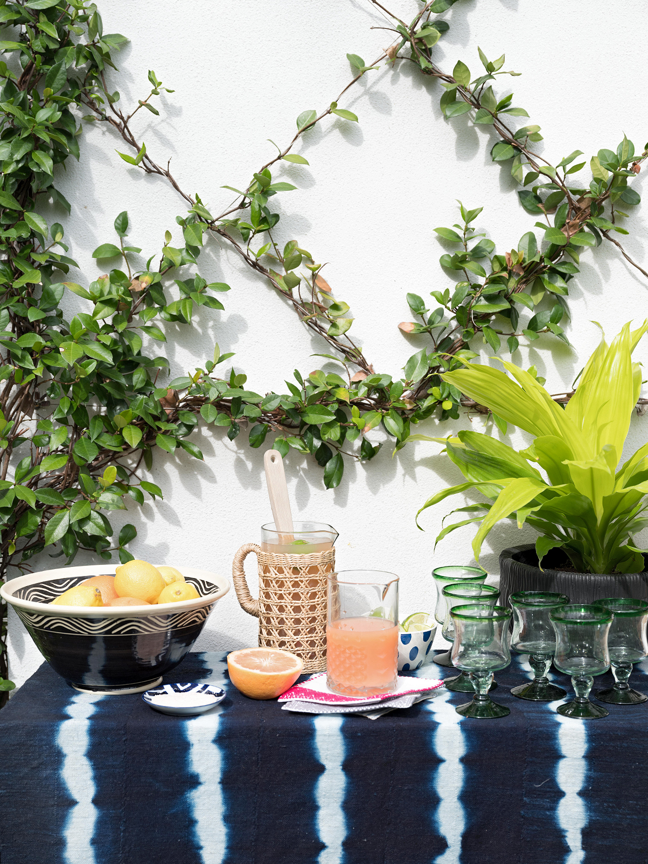 outdoor drink station with foliage lattice backdrop