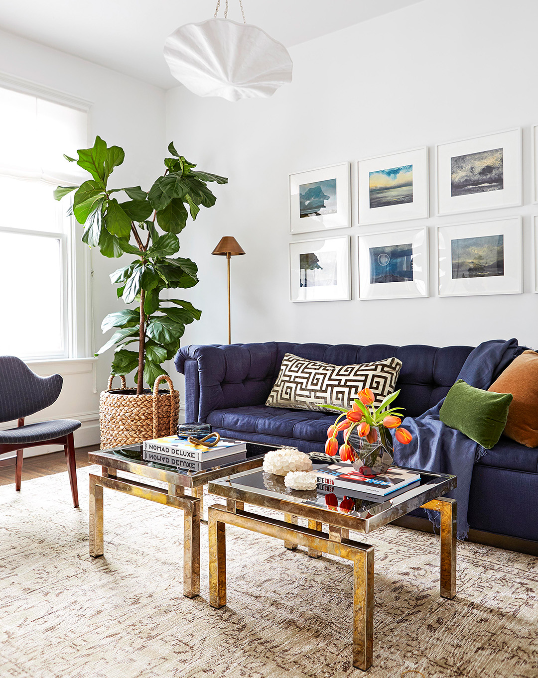 Modern Living Room With Large Blue Velvet Couch Gold And Glcoffee Tables