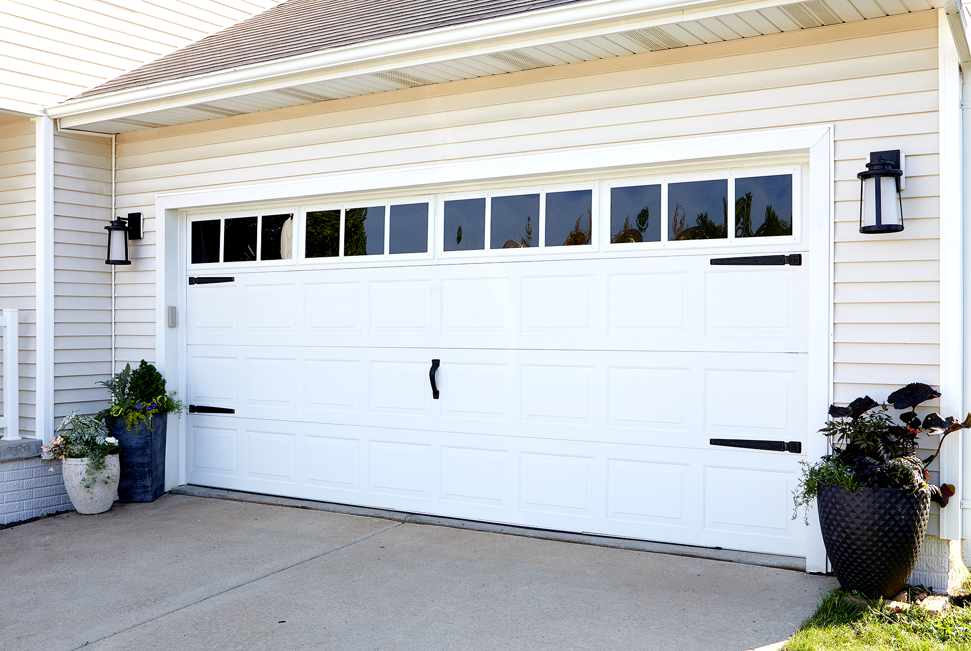 renovated garage door with decorative hardware