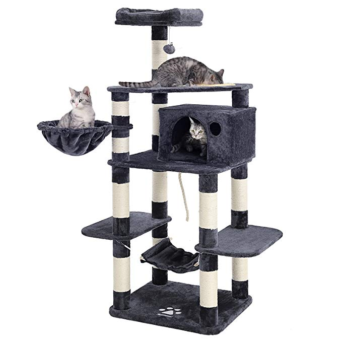 Three cats playing in gray and white cat tower