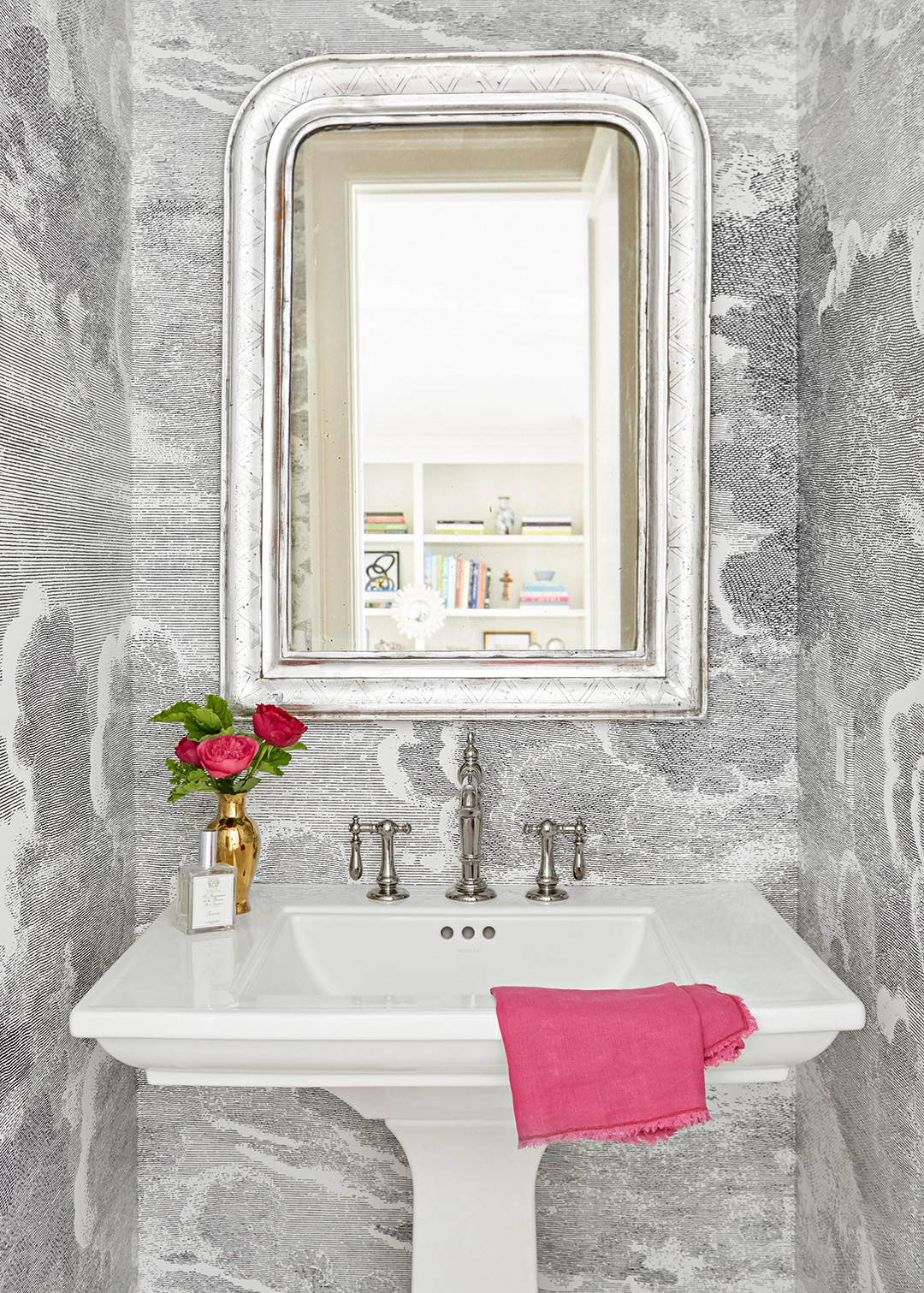 bathroom with silver mirror large white sink and cloud wallpaper