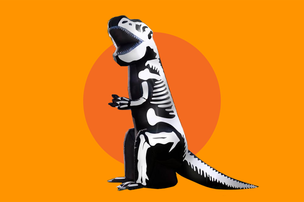 inflatable black dinosaur with a white skeleton pattern, against an orange background