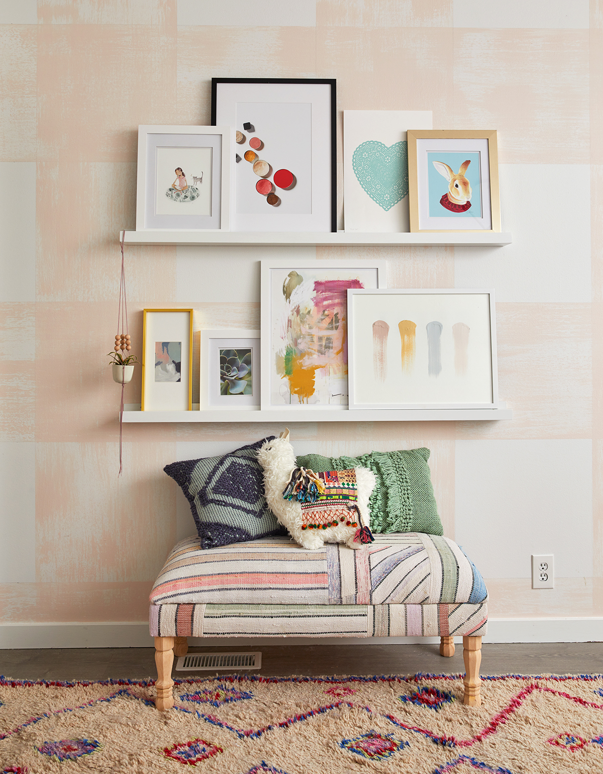 stacked white photo ledges with frames on wall