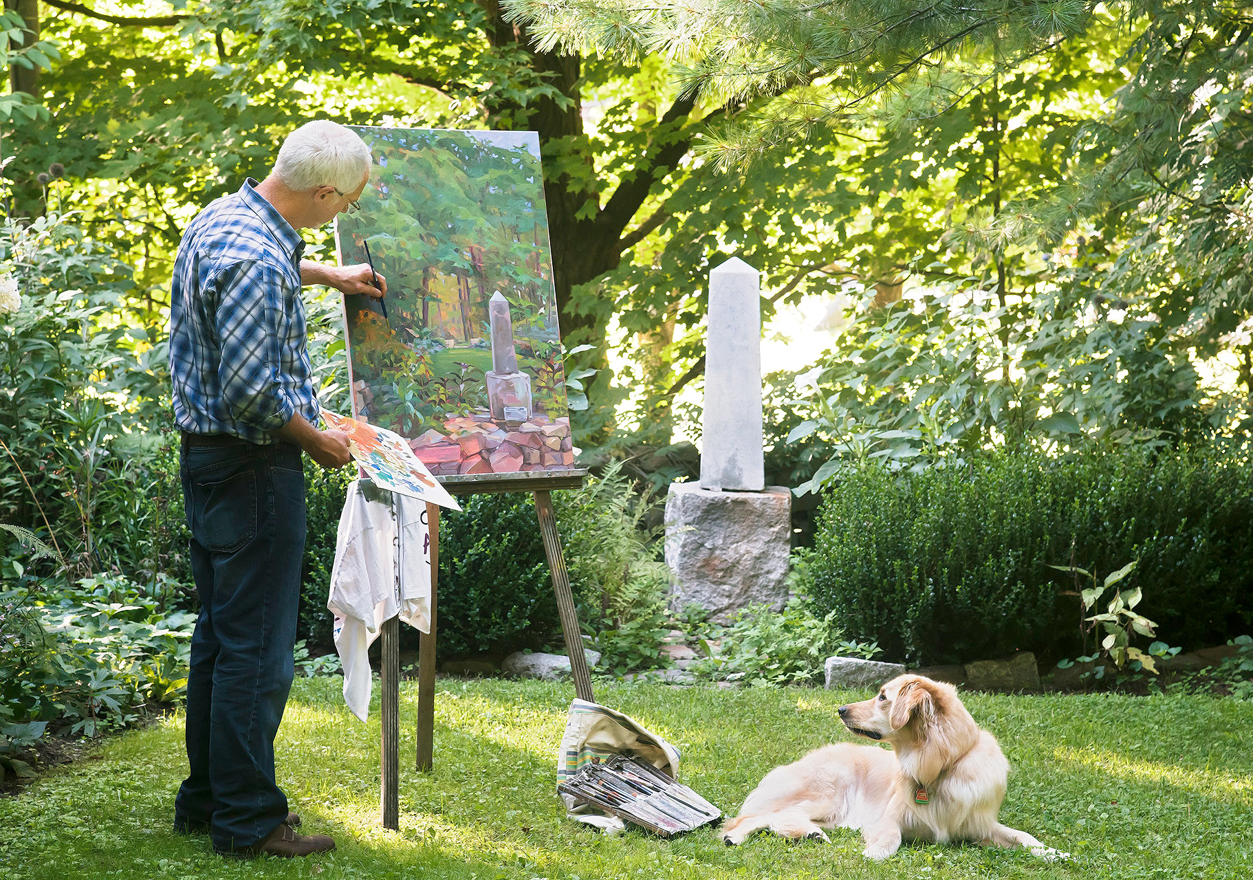 man painting nearby obelisk structure on canvas
