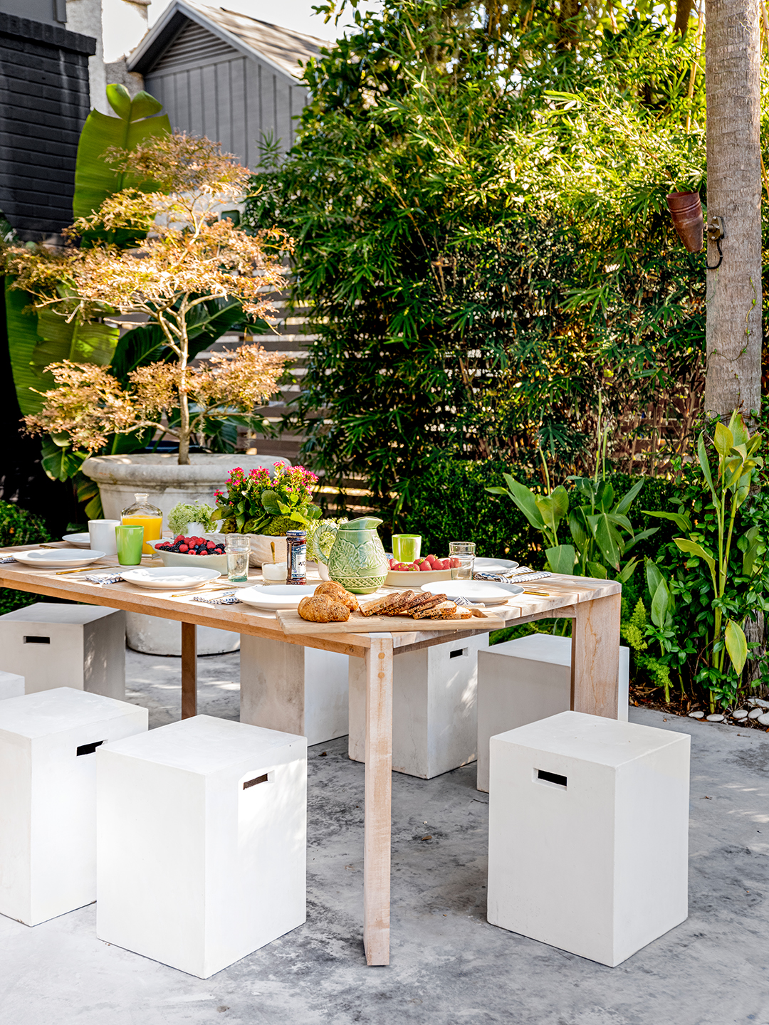 white stools and wood table on concrete deck