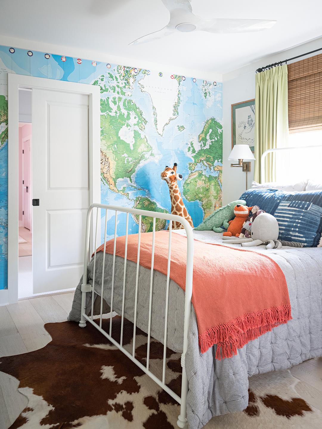 map wall bedroom with stuffed animals