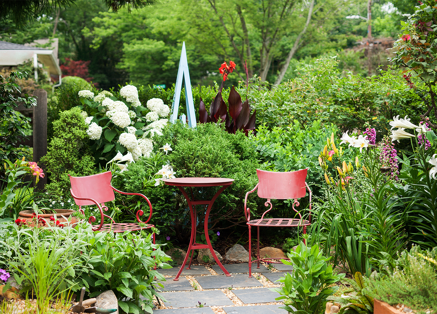 colorful urban garden red chairs table seating