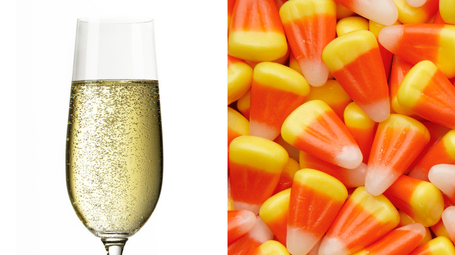 Glass of bubbly prosecco and pile of candy corn
