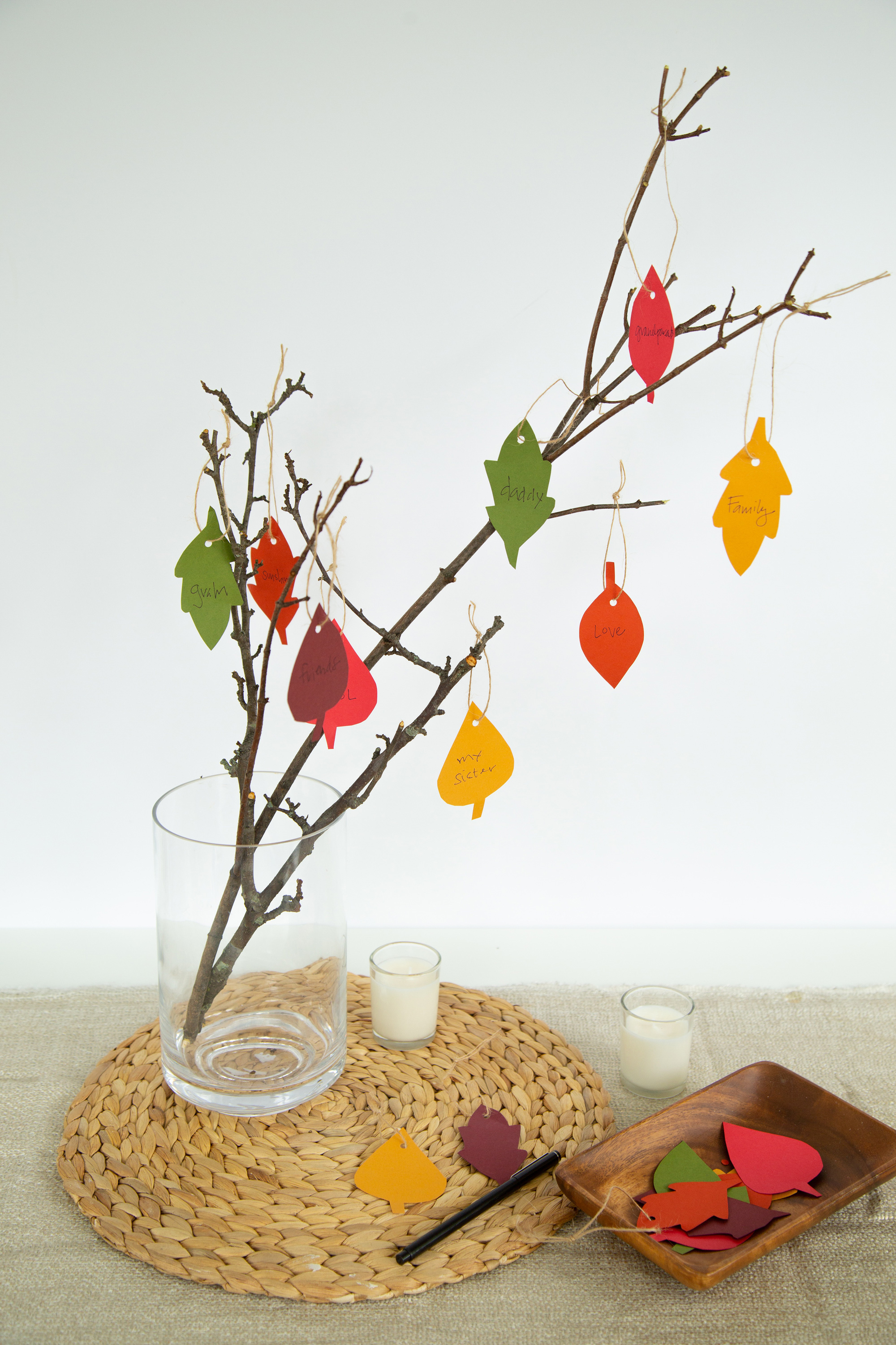 finished gratitude tree in vase with hanging paper leaves thanksgiving