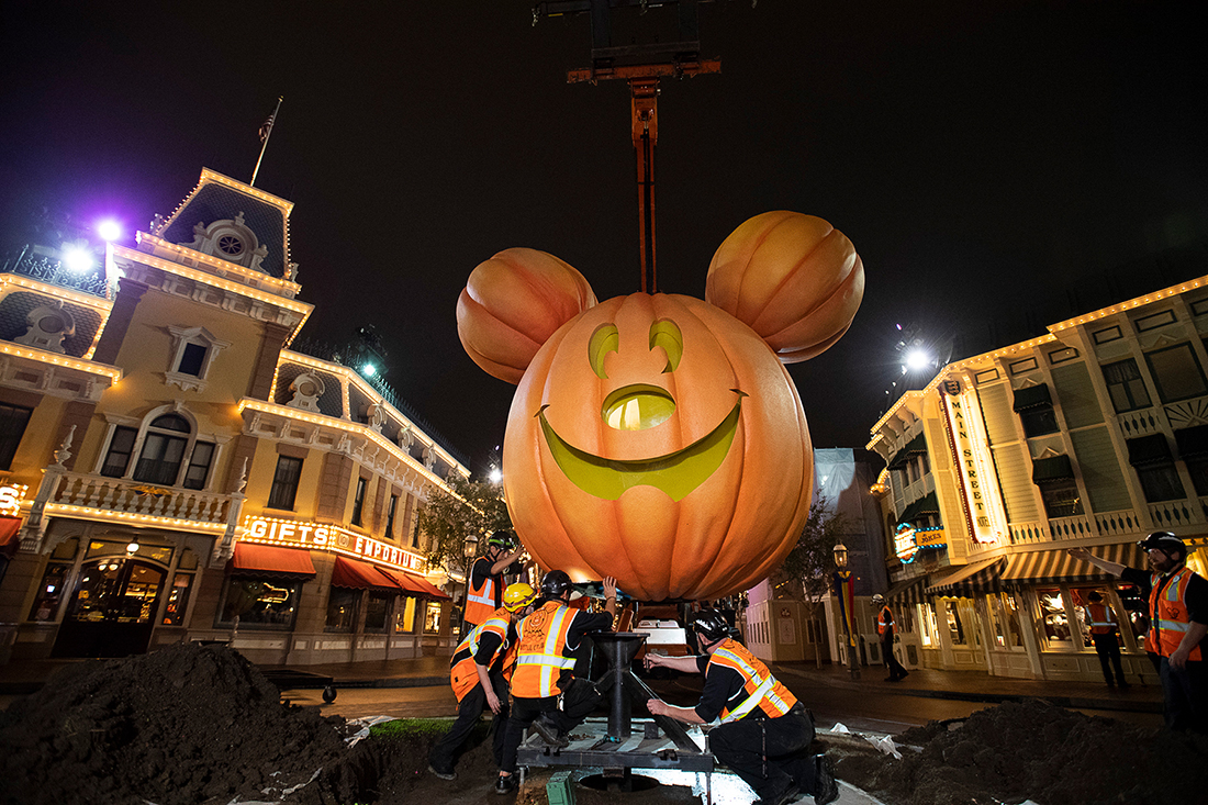 Workers set up the Mickey Mouse pumpkin in Disneyland, California