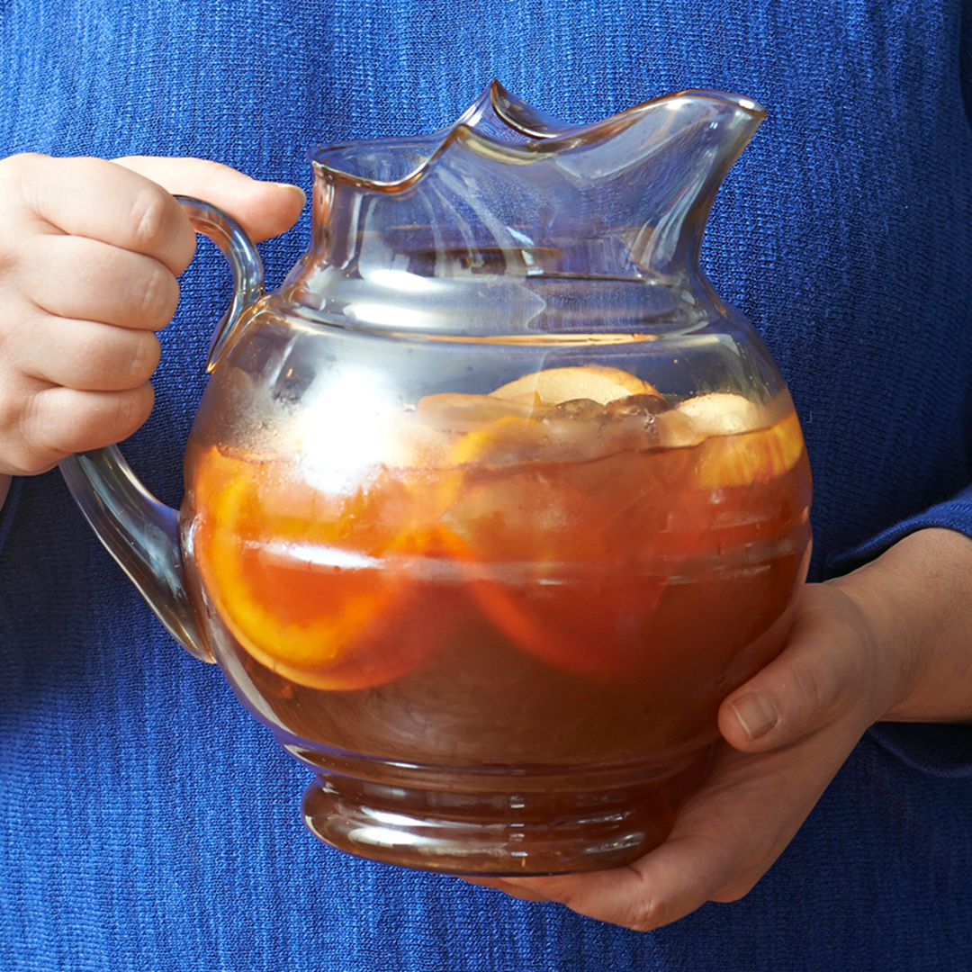 Cranberry Cider Sangria in glass pitcher