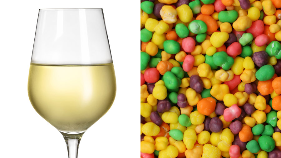 Glass of white wine (reisling) with pile of nerds candy