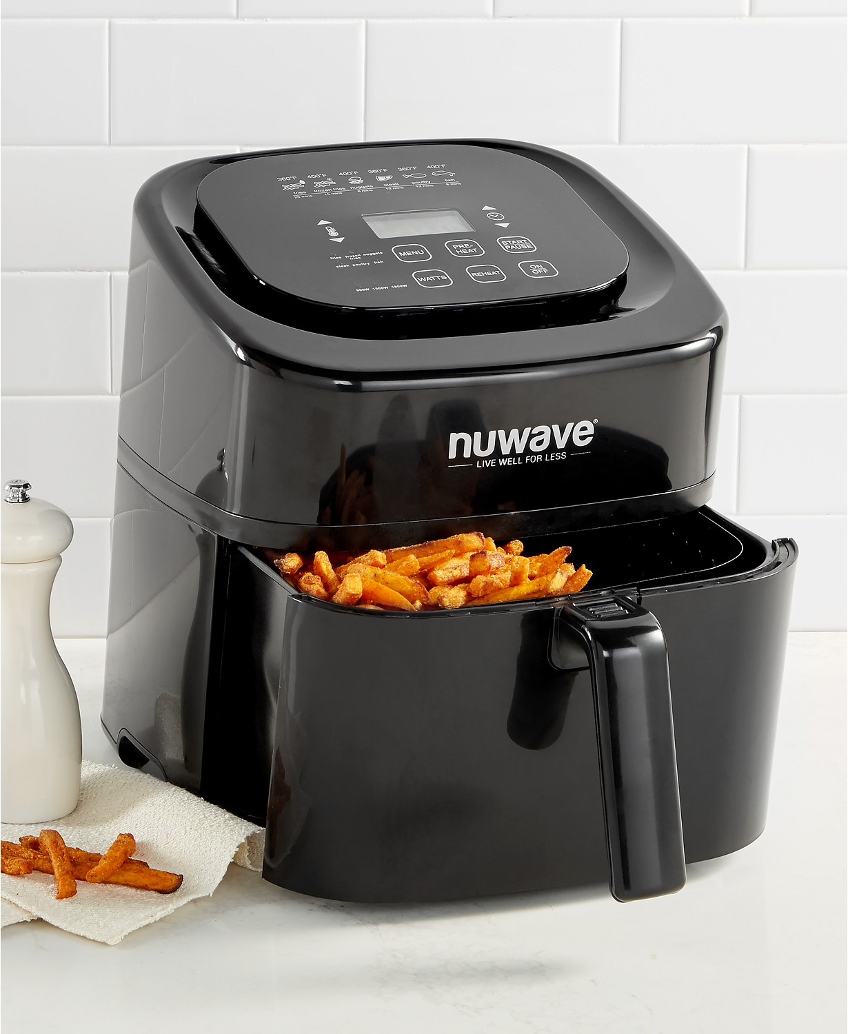 Black Macy's NuWave Air Fryer filled with cooked French fries