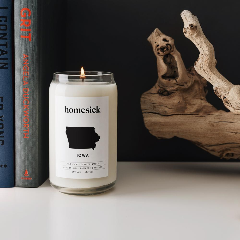 iowa homesick soy candle on book shelf