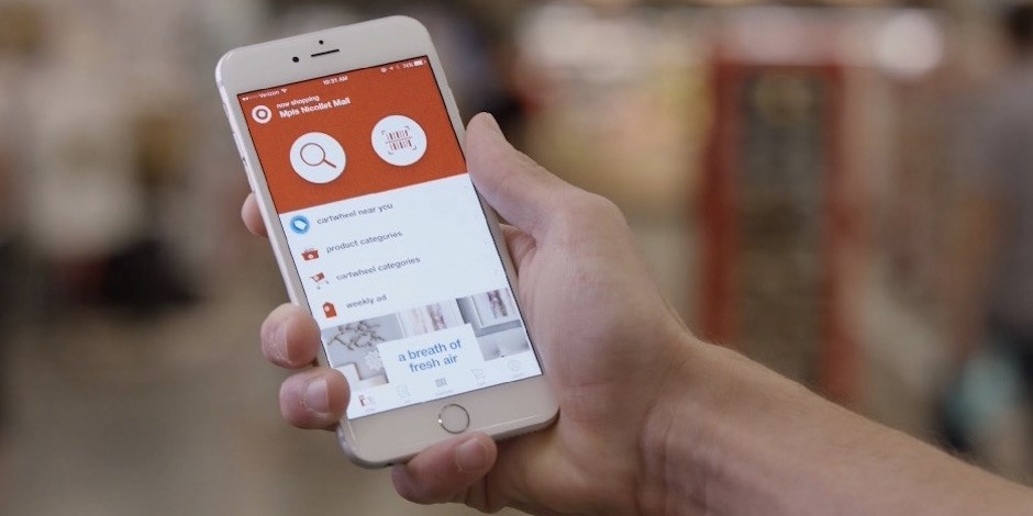 Person holding an iPhone with the Target app displayed