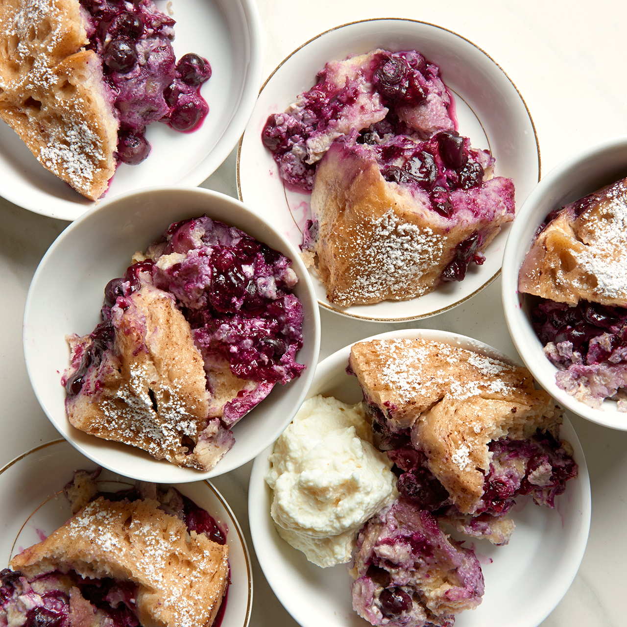 portioned blueberry-french toast casserole in dishes