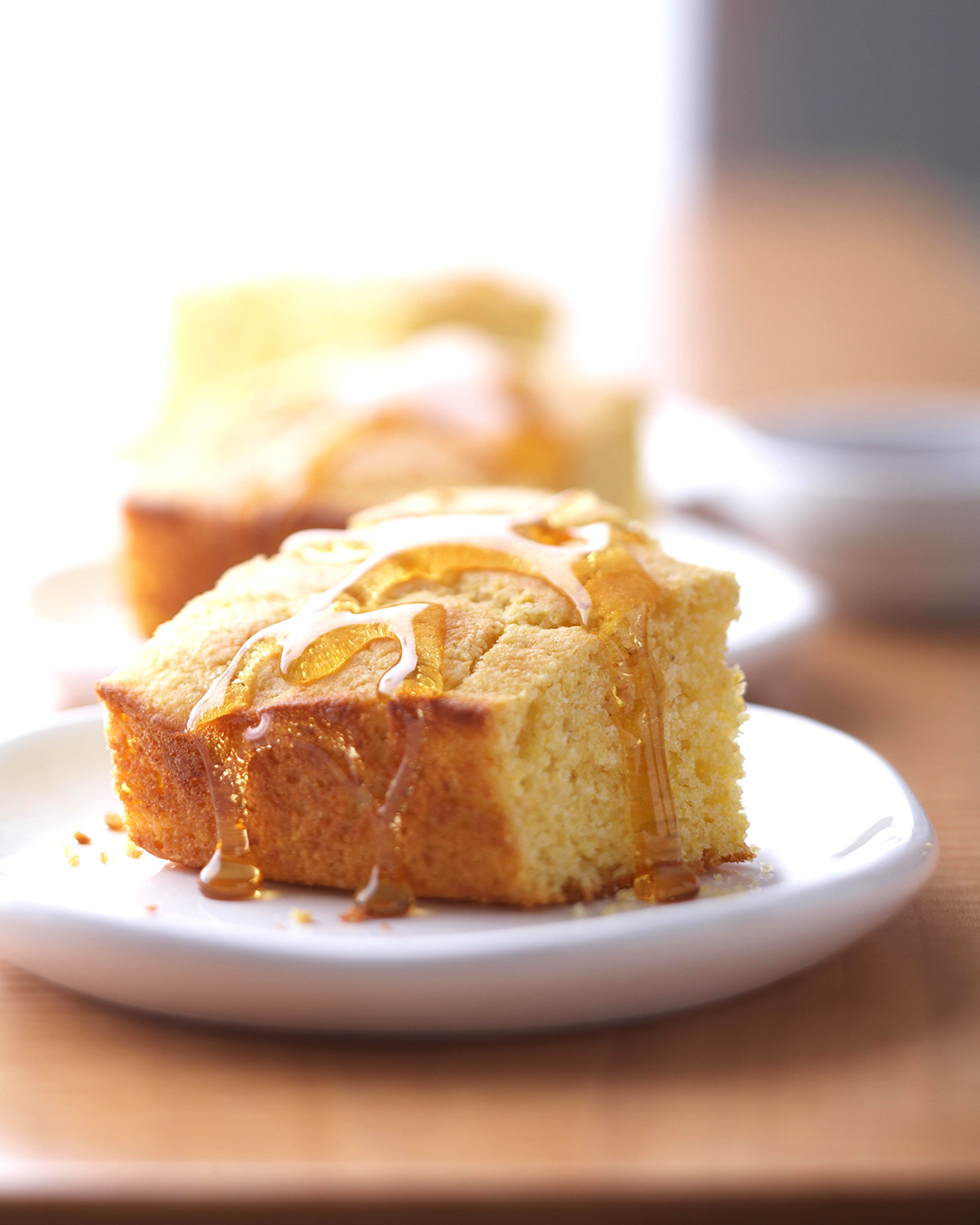 classic corn bread with honey drizzled on top