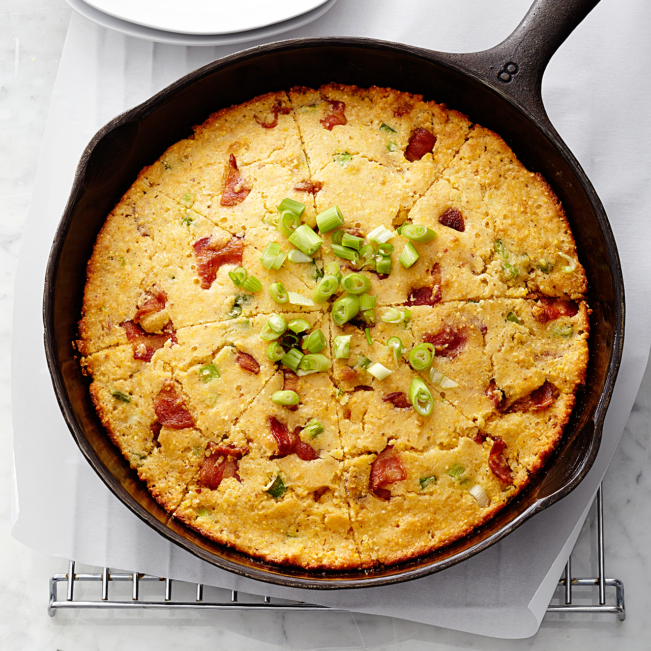 skillet corn bread topped with green onion