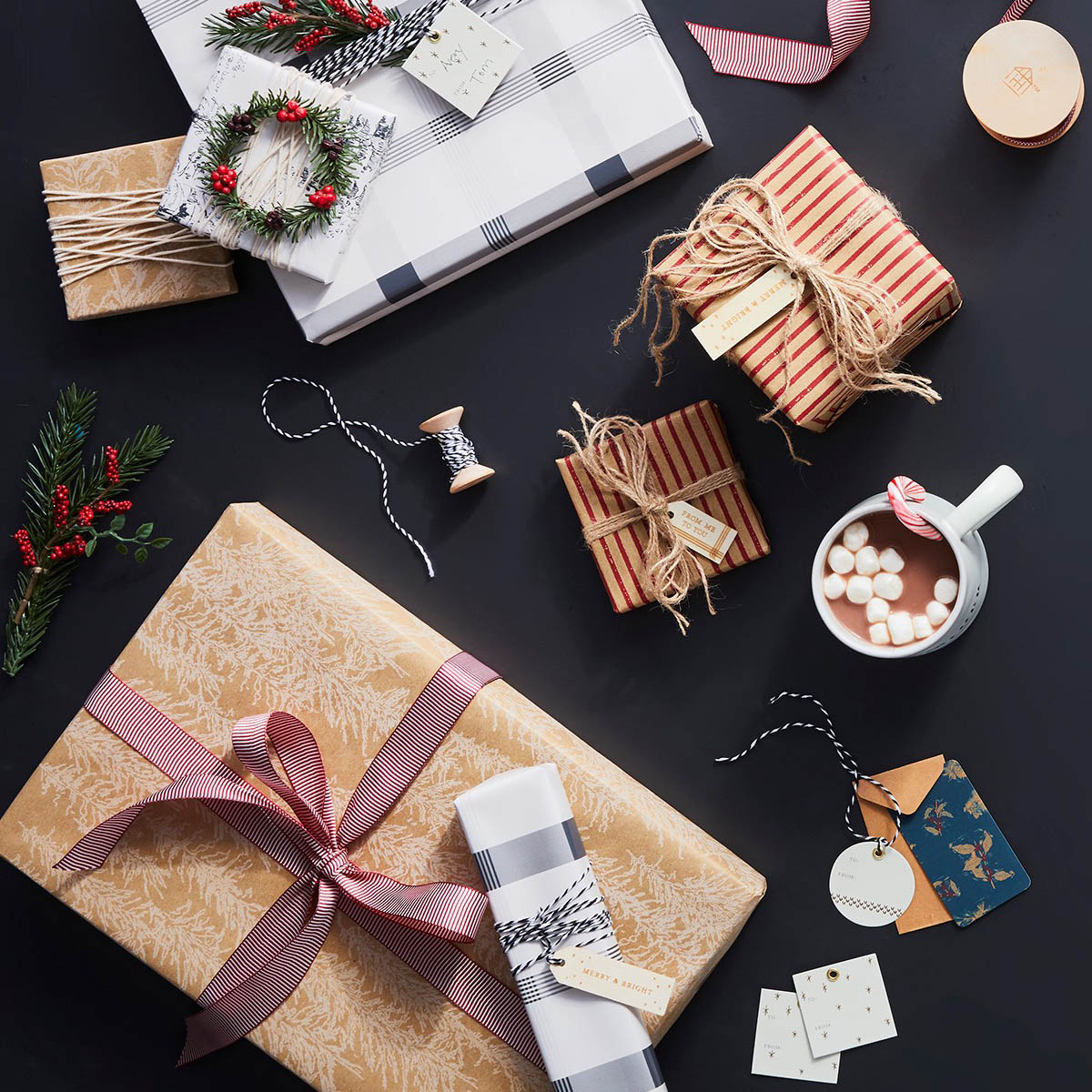 Wrapped gifts with gift tags and a mug of hot chocolate