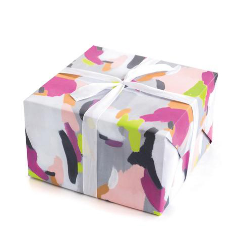 Gift wrapped with pink and gray and green wrapping paper
