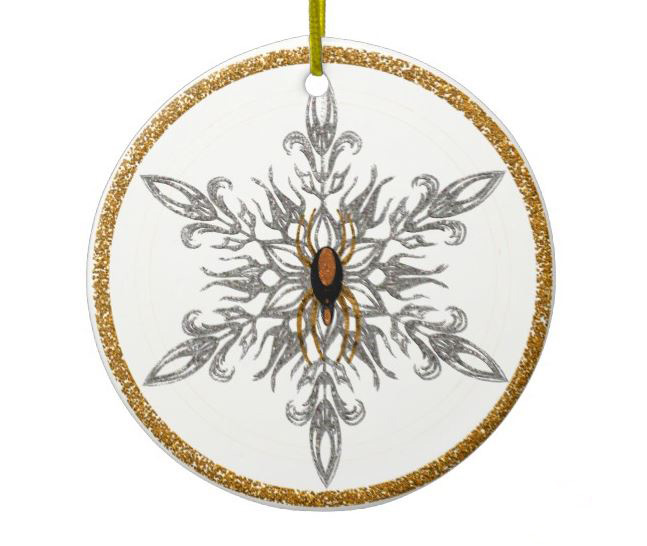 white ornament with gold glitter border and filigree snowflake with spider in center