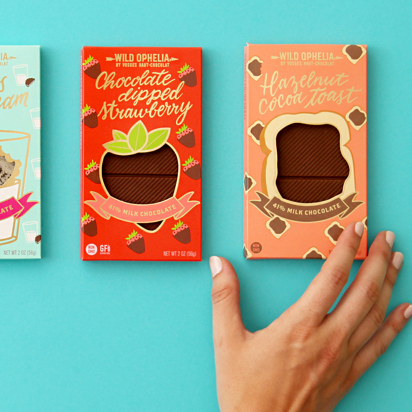 four wild ophelia chocolate bars and hand